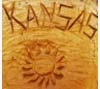 Chair chainsawed from trunk of cottonwood tree originally on Kansas Capitol grounds, 1984