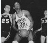Bob Boozer, All-American forward at Kansas State University, prepares to shoot, 1958