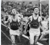 Milers Glenn Cunningham and Archie San Romani crossing finish line at Kansas Relays