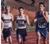 Christian Smith running relay for Pawnee Heights High School, Rozel, in 2002