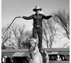 Reb Russell performing bull whip act with his horse, Rebel