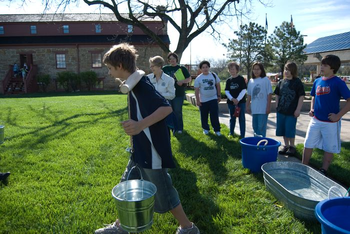 Carrying water with a yoke and buckets