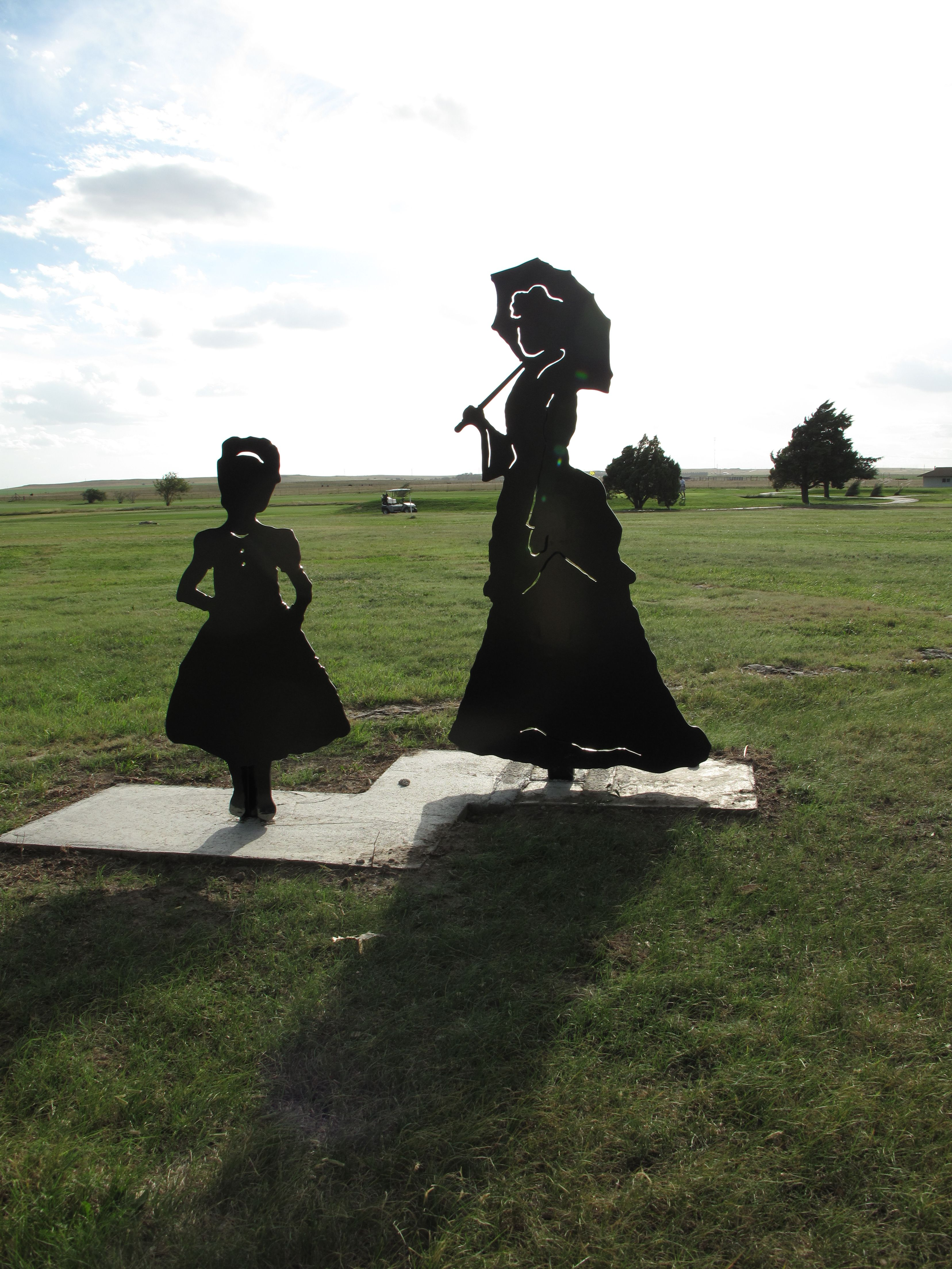 Silhouette of a well-dressed woman at Hays