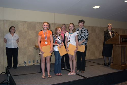 Nelson, Ramberg, and Marple with teacher Bertels, 1st place, Jr. group performance