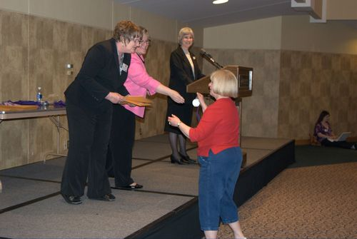 Accepting award for Brandon Martin, teacher Janet Berry, 2nd place, Sr. website