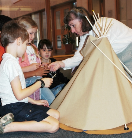 Setting up a miniature tipi